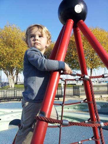 We went to the playground this weekend, and Calvin climbed to the top of this thing. I think he really likes looking down on everybody ... just like mommy.