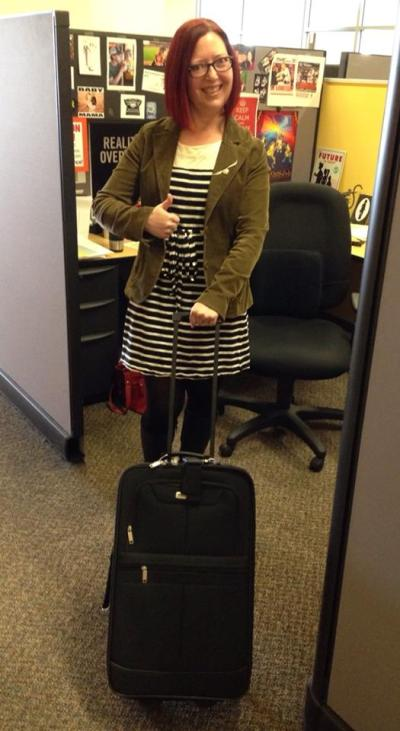 Here I am in my cube at work showing off the luggage the corporate overlords gave me for five years of service. Think they are trying to tell me something?
